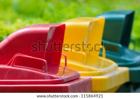 Colorful Recycle Bins In The Park - stock photo