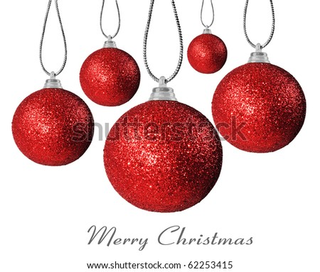 Colorful red christmas decoration baubles on white with space for text - stock photo