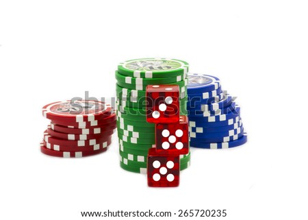 Colorful red dices and a stack of poker chips. - stock photo