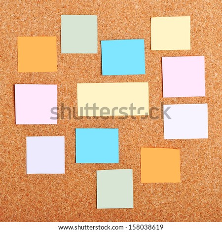 colorful reminder notes on a corkboard - stock photo
