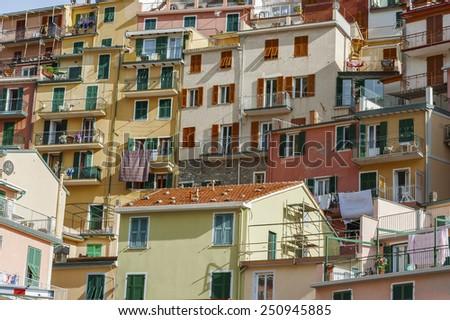 Colorful residential buildings in Riomaggiore, Cinque Terre, Liguria, Italy, Europe. - stock photo