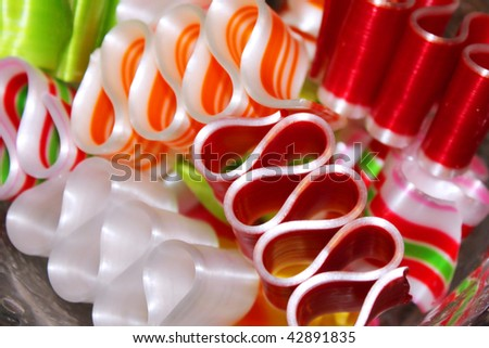 Colorful ribbon candy in a bowl - stock photo