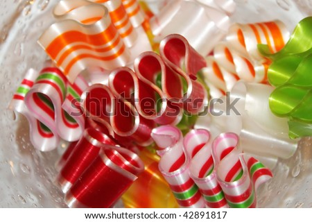 Colorful ribbon candy in a glass dish - stock photo