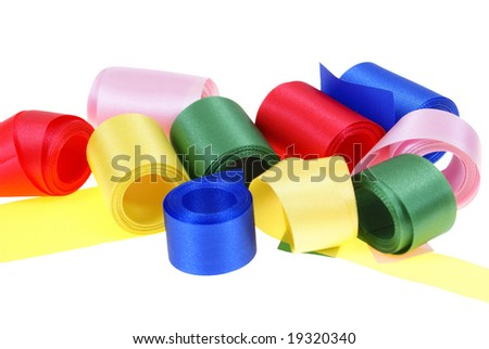 colorful ribbon rolled up in rolls isolated on white background