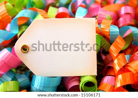 Colorful ribbons surrounding a blank tag. - stock photo