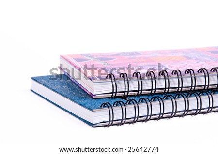 Colorful ring bound books that are isolated on the white background - stock photo