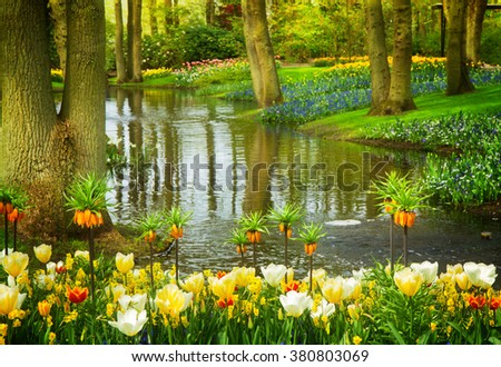 Colorful river landscape  in dutch garden 'Keukenhof', Netherlands, toned - stock photo