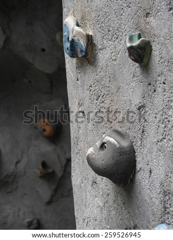 Colorful rock on rock climbing wall