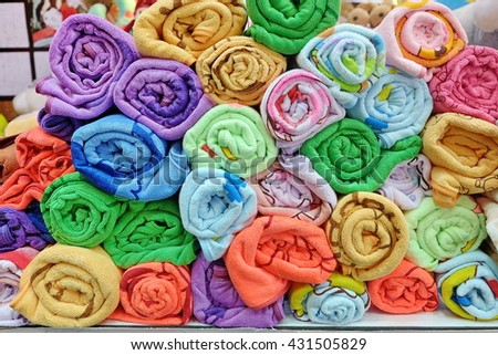 colorful rolled towels  - stock photo