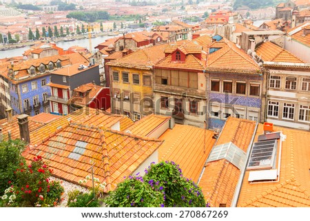 colorful roofs of  old houses in historic part of town, Porto, Portugal - stock photo