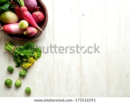 Colorful root vegetables with spring vegetables. (with a kind of rape blossoms) - stock photo