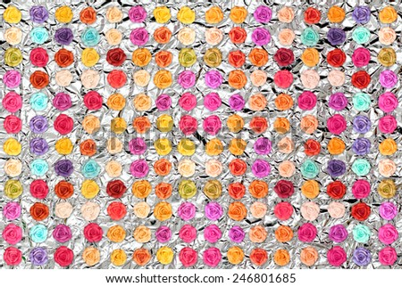 Colorful roses on Shiny silver foil texture background - stock photo