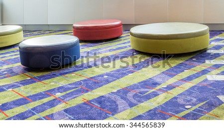 Colorful Round Cushions on a Bright Patterned Carpet