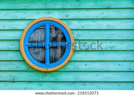 colorful round window on wooden surface. - stock photo