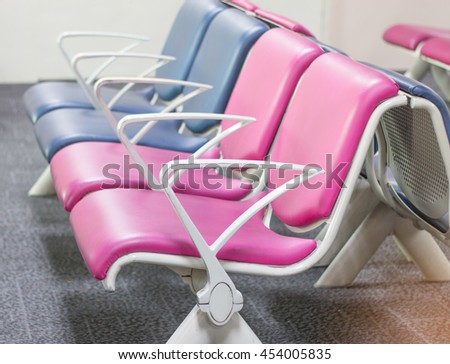 colorful row of bench in the terminal of airport. empty airport terminal waiting area with chairs. - stock photo
