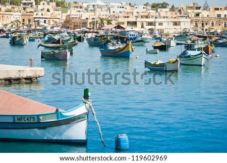 Colorful rowing boats at marina at Malta a mediterranean island - stock photo