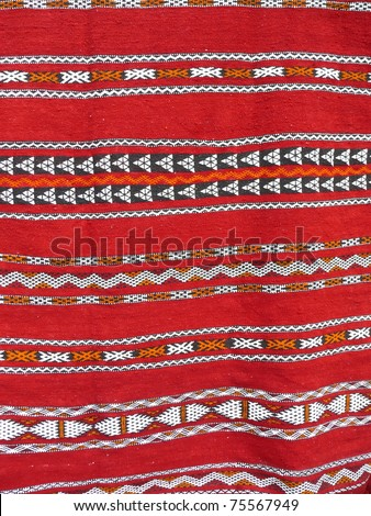 Colorful rug close up. More of this motif & more textiles in my port. - stock photo