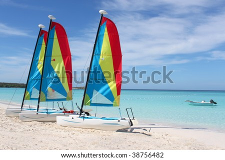 Colorful sailboats for rent on a tropical beach at Half Moon Cay in the Bahamas - stock photo