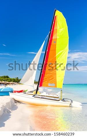 Colorful sailing boat at the famous Varadero beach at the Caribbean sea in Cuba - stock photo