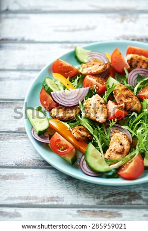 Colorful salad with grilled chicken - stock photo