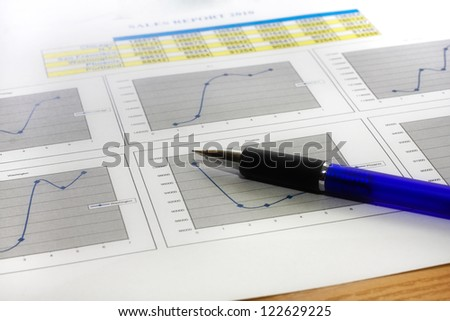 Colorful sales charts with pen. - stock photo