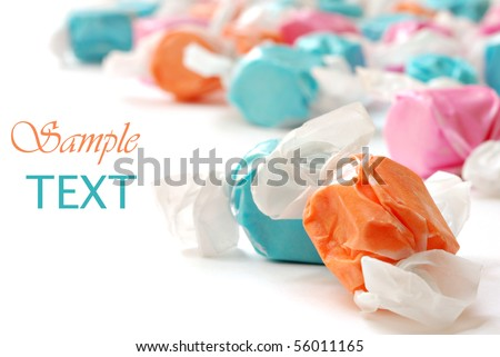 Colorful salt water taffy on white background with copy space.  Macro with extremely shallow dof. - stock photo