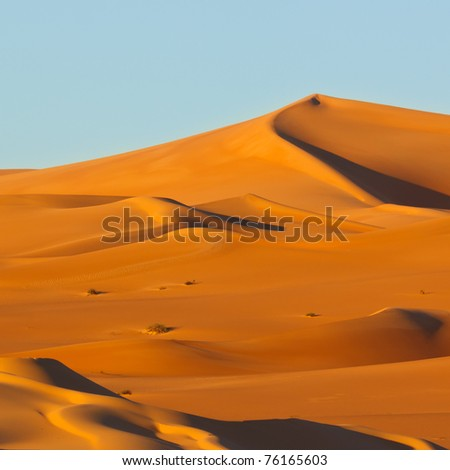 Colorful sand dunes at sunrise - Awbari Sand Sea, Sahara Desert, Libya - stock photo