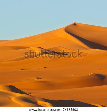 Colorful sand dunes at sunrise - Awbari Sand Sea, Sahara Desert, Libya - stock photo
