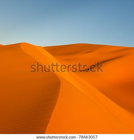 Colorful Sand Dunes at Sunset in the Awbari Sand Sea, Sahara Desert, Libya - stock photo