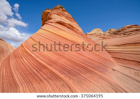 "Colorful sandstone butte in ""The Wave"" - a dramatic erosional sandstone rock formation located in North Coyote Buttes area of Paria Canyon-Vermilion Cliffs Wilderness at Arizona-Utah border. - stock photo"