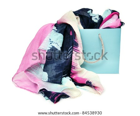 colorful scarf in shopping bag isolated on a white background - stock photo