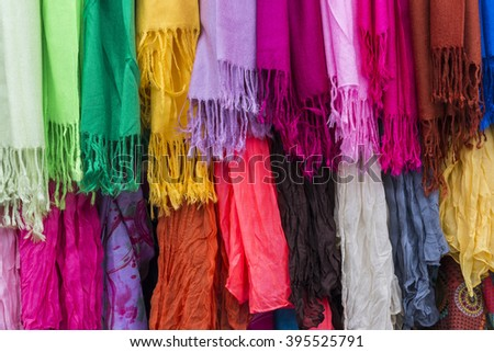 Colorful scarfs and cloth in various bright colors.