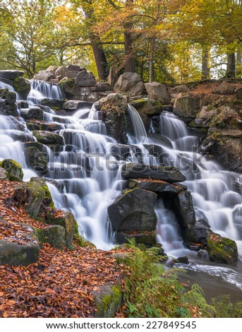 Colorful scenic Cascade in Virginia Water Park, UK - slow shutter speed effect - stock photo