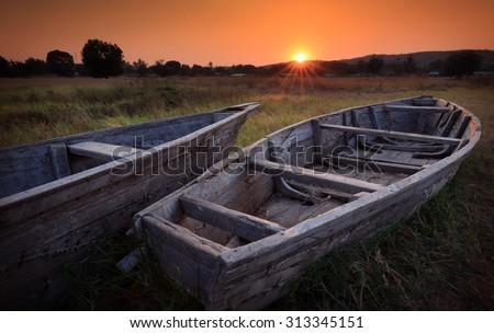 Colorful scenic sunrise with fishing boats in the foreground in Karema, Lake Tanganyika, Tanzania - stock photo