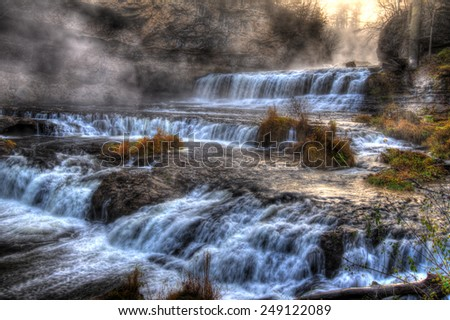 Colorful scenic waterfall in High Dynamic Range. - stock photo