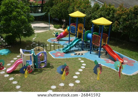 Colorful school playground with slides and toys on a sunny day - stock photo