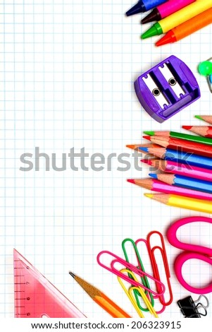 Colorful school supplies corner border over graphing paper