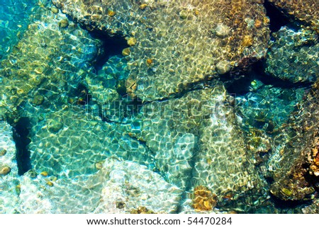 Colorful sea stones under the water. Abstract background. - stock photo