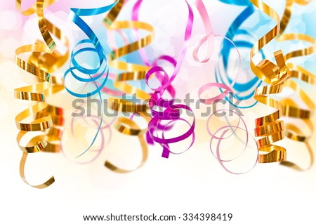 Colorful serpentine streamers hanging on white background - stock photo