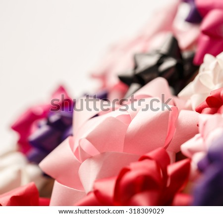 Colorful set of decorative bows as background