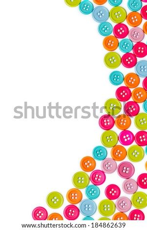 Colorful sewing buttons background with copy space - stock photo