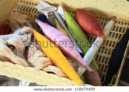 Colorful Sewing threads on the basket - stock photo