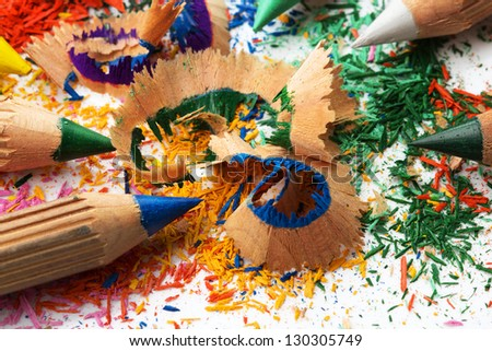 Colorful sharpened pencils and  shavings - stock photo