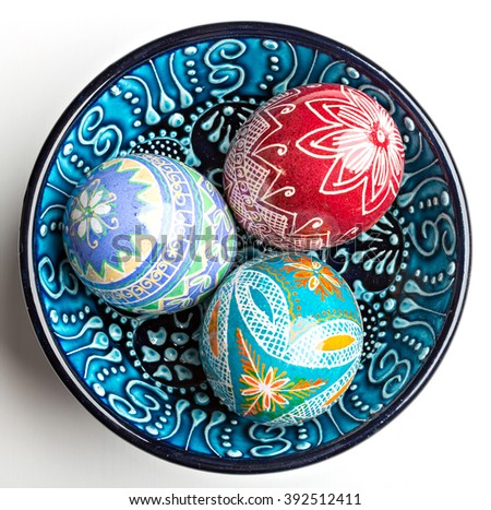 colorful shiny easter eggs in blue bowl