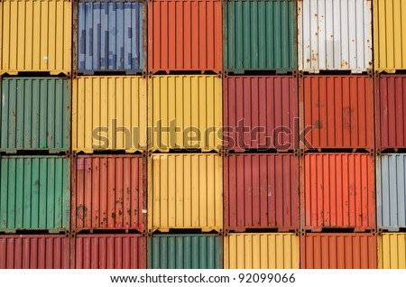 Colorful ship cargo containers stacked up in a port. - stock photo