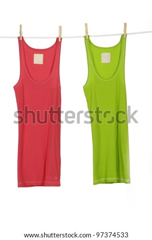 colorful shirt clothespins on rope - stock photo
