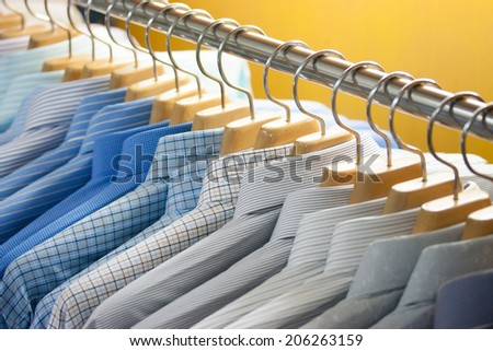 Colorful shirt on hangers - stock photo