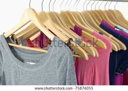 colorful shirt rack on white - stock photo
