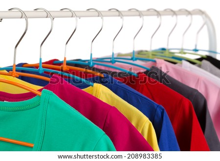 Colorful shirts on hangers, isolate on white.