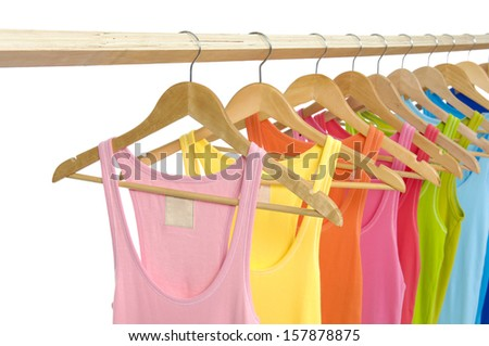 colorful shirts on wooden hangers - stock photo